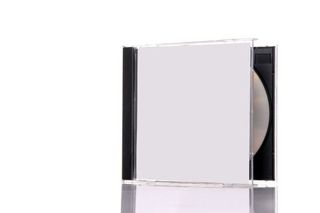 dvdr: a compact disc in the box, isolated on white background with reflection. Almost closed box