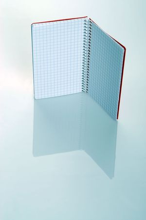Red notebook isolated with reflection photo