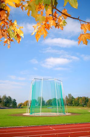 Area for javelin and hammer throwing on the athletics field. Surrounded by autumn leafs photo