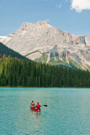 couple in kayak on a canadian lake photo