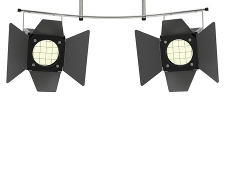 Two stage spotlights looking to the viewer and isolated on white background photo