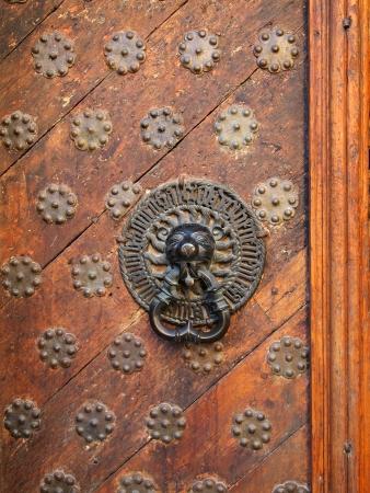 doorhandle: Old-fashioned wooden door with ancient doorhandle