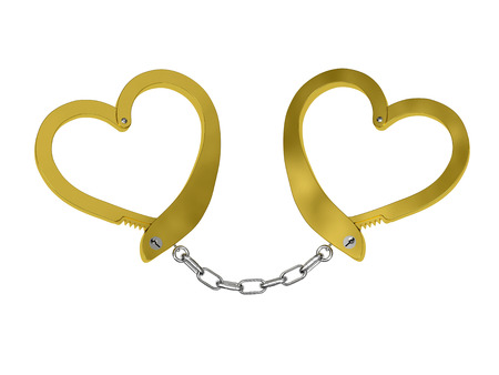 Handcuffs of love isolated on white background (conceptual idea of marriage) photo