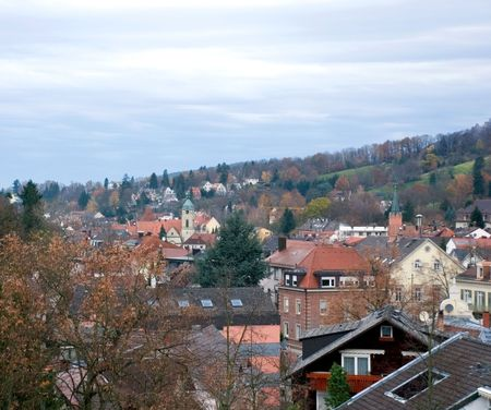 small quiet town stands in hills. Autumn trees under gloomy sky Stock Photo - 3275403