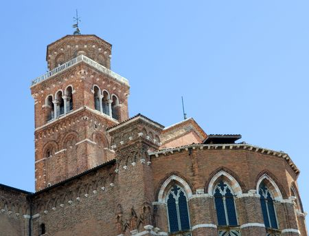lido: Picture top part of church in Venice on a background blue sky  Stock Photo