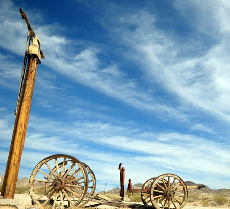 The blue sky and the broken vehicle, all that remains from trailblazers of the wild West in the Valley of death Nevada Stock Photo