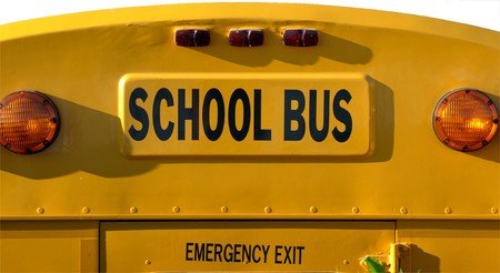 Yellow school bus against white background