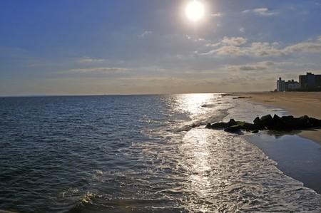 Evening sunset ashore ocean. Waves wash a bank Stock Photo