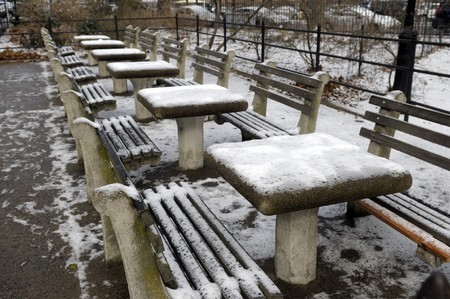 Chess tables outside in the park covered with snow