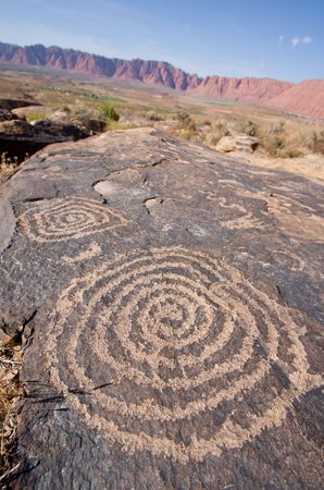 native american art: Petroglyphs carved onto rock surface by prehistoric Native American(s) at Anasazi Canyon, Utah, USA Stock Photo