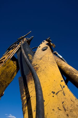 Close up of mechanical arm of backhoe tractor.
