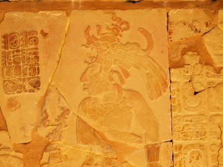 Carved depiction of King Pakal and glyphs. King Pakal was the ruler during the golden years of the ancient Mayan city of Palenque, Chiapas, Mexico. photo