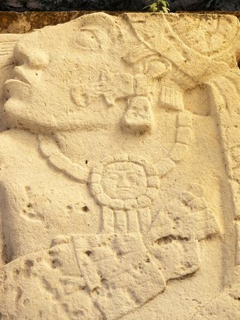 depiction: Close up of depiction of possible prisoner of war carved out of limestone in the ancient Mayan city of Palenque, Chiapas, Mexico. Stock Photo