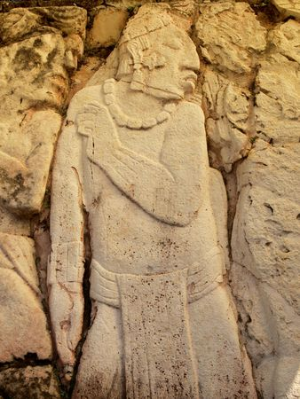 Depiction of possible prisoner of war carved into limestone at the ancient Mayan city of Palenque, Chiapas, Mexico.