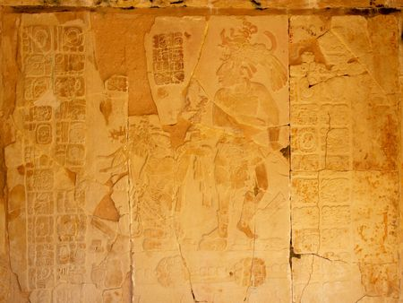 Ancient panel of carvings depicting King Pakal and his kneeling mother at the Mayan city of Palenque, Chiapas, Mexico.