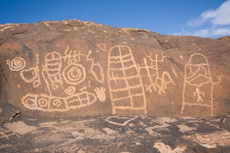 anasazi: Petroglyphs carved onto rock surface by prehistoric Native American(s) at Anasazi Canyon, Utah, USA Stock Photo