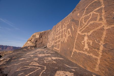 Petroglyphs carved onto rock surface by prehistoric Native American(s) at Anasazi Canyon, Utah, USA photo