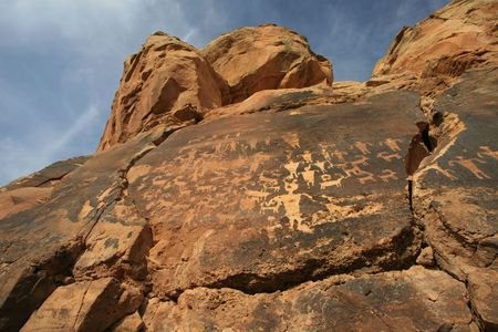 anasazi: Wide angle view of panel of petroglyphs carved onto rock surface by prehsitoric Native American(s) in southern Utah desert, USA. Stock Photo