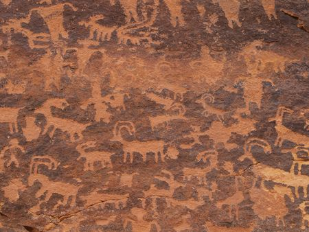 Close up of panel of petroglyphs carved onto rock surface by prehistoric Native American(s) in southern Utah desert, USA. photo