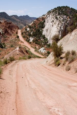 cottonwood canyon: Rugged, remote dirt road leading through harsh desert landscape. Southern Utah, USA. Stock Photo