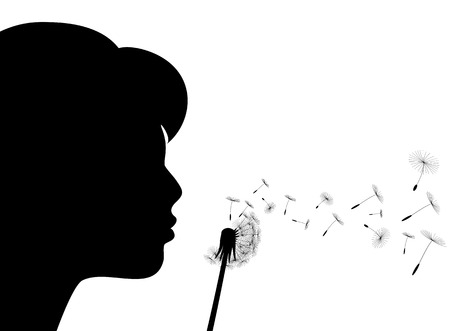 black seeds: Girl blows to a dandelion