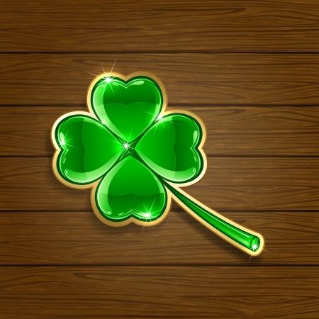 Decorative leaf of a clover on wooden background, illustration Vector