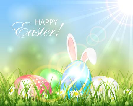 イースターの背景に色とりどりの卵、草、イラストでウサギの耳。