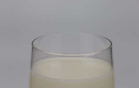 mammary: Milk is a pale liquid produced by the mammary glands of mammals.I focus on the glass edge Stock Photo