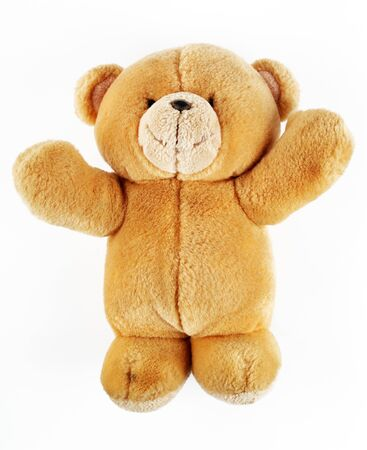 Toy teddy bear on a white background, macro, isolate