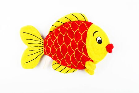 Toy plush fish, on a white background, isolate