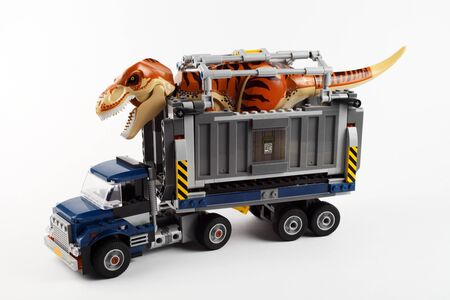Toy truck with dinosaur, tyrannosaurus, white background, isolate