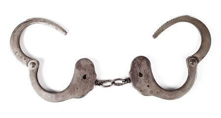 police handcuffs on a white background, isolate, close-up