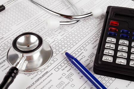 Healthcare costing. Medical phonendoscope, calculator, pen.