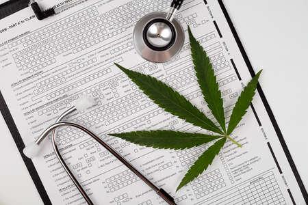 Cannabis leaf, medical phonendoscope on a white background