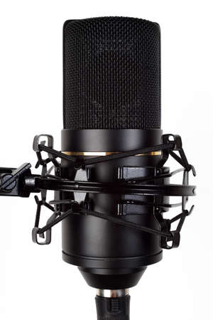 Studio condenser microphone on a microphone stand, close-up. Isolate on a white background.