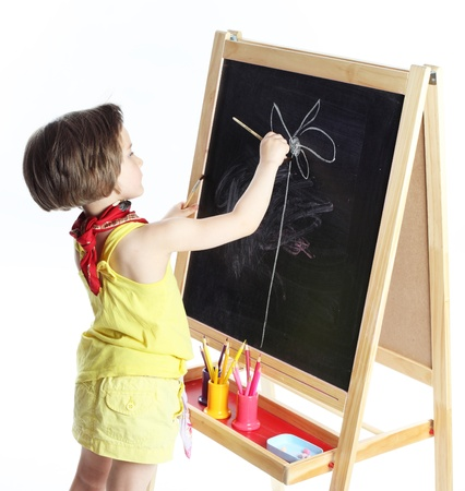 the girl draws on a board