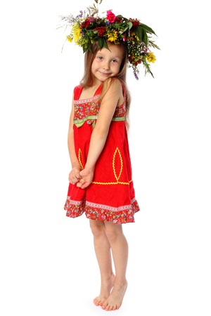3 4 length: the barefooted girl in a red dress with a wreath on the head isolated on white