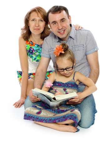 the father mother and the daughter of 6 years read the book isolation Stock Photo - 15328277