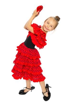c96ce0be7  15327656 - La chica en un vestido rojo españoles de pie la chica tiene los  zapatos en una serie de tacón alto aislados en blanco