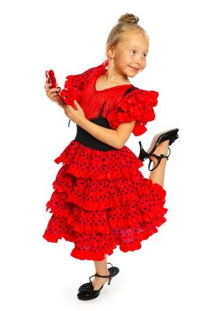 6b03e2ba8  15327662 - La chica en un vestido rojo españoles de pie la chica tiene los  zapatos en una serie de tacón alto aislados en blanco