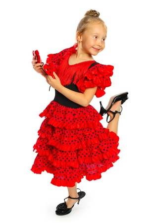 the girl in a red Spanish dress standing the girl has shoes on a high heel  series  isolated on white  photo