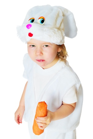 the little girl in an image of a hare with carrots in hands in studio on a white background photo