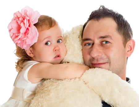 the father with the dear 2-year-old daughter in studio on a white background photo