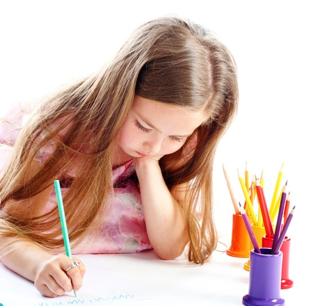 the beautiful girl draws color pencils isolated white background Banque d'images