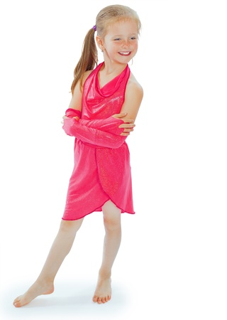 Full length portrait of a happy little girl playing, isolated on white background photo
