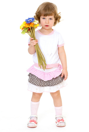 Beautiful little girl with beautiful hairstyle holds a bouquet of flowers on a white background on Holiday. Isolated on white background. photo