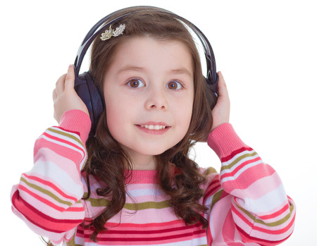 Beautiful cute happy little girl with headphones.Isolated on white .