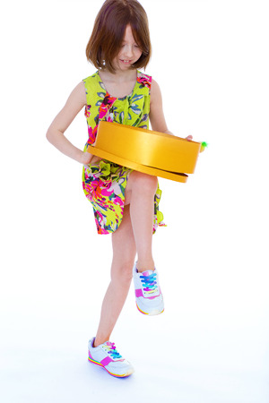 spacey: young girl with big round box.Isolated on white .