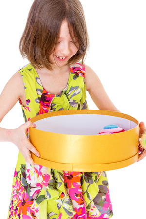young girl with big round box.Isolated on white .
