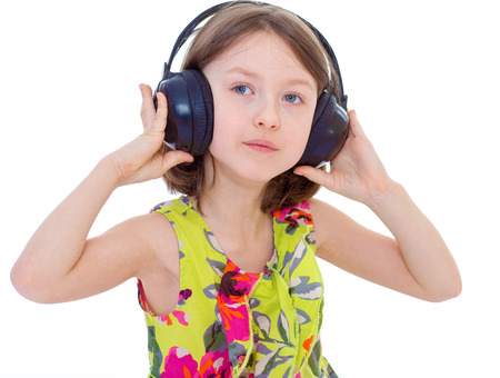 Portrait of cute girl wearing headphones over a white background photo